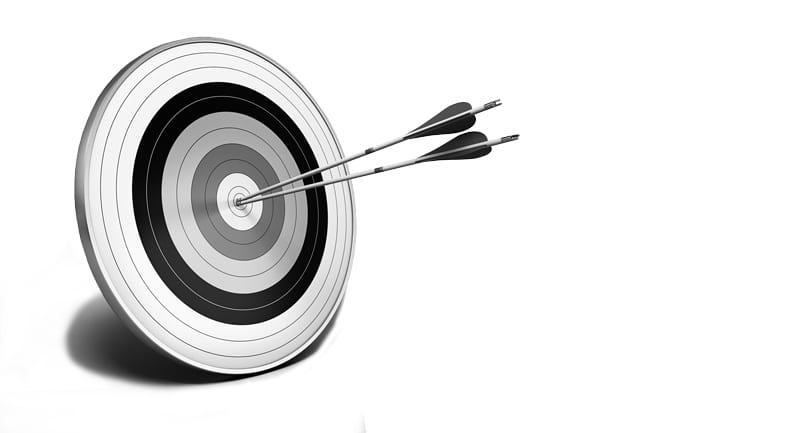 Two arrows in the bullseye of an archery target