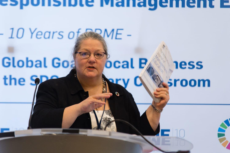 Carole Parkes mid-presentation at a podium