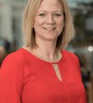 Lynn Hawkins in a red dress smiles