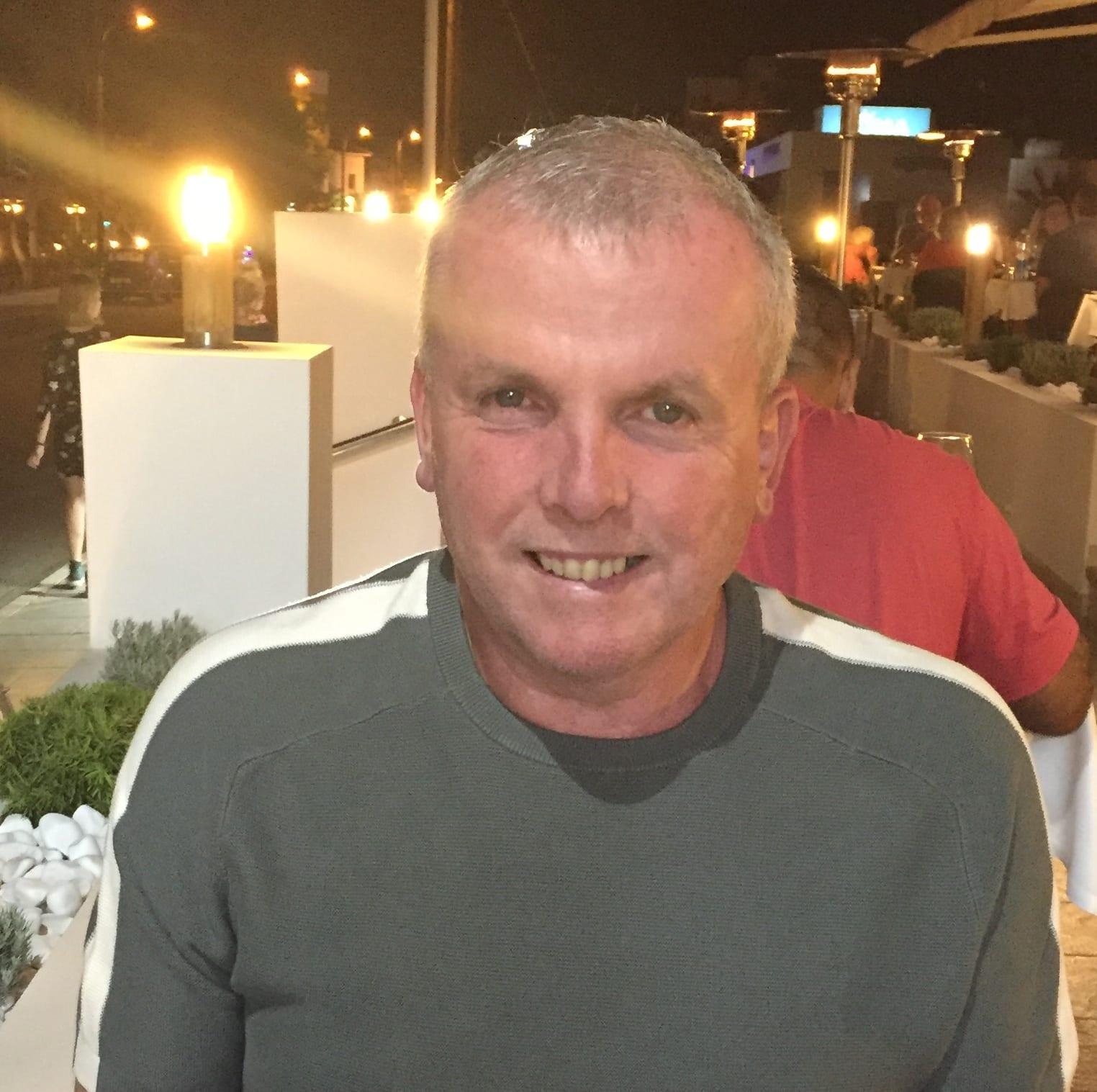 Paul Broadhead sits outside at a restaurant