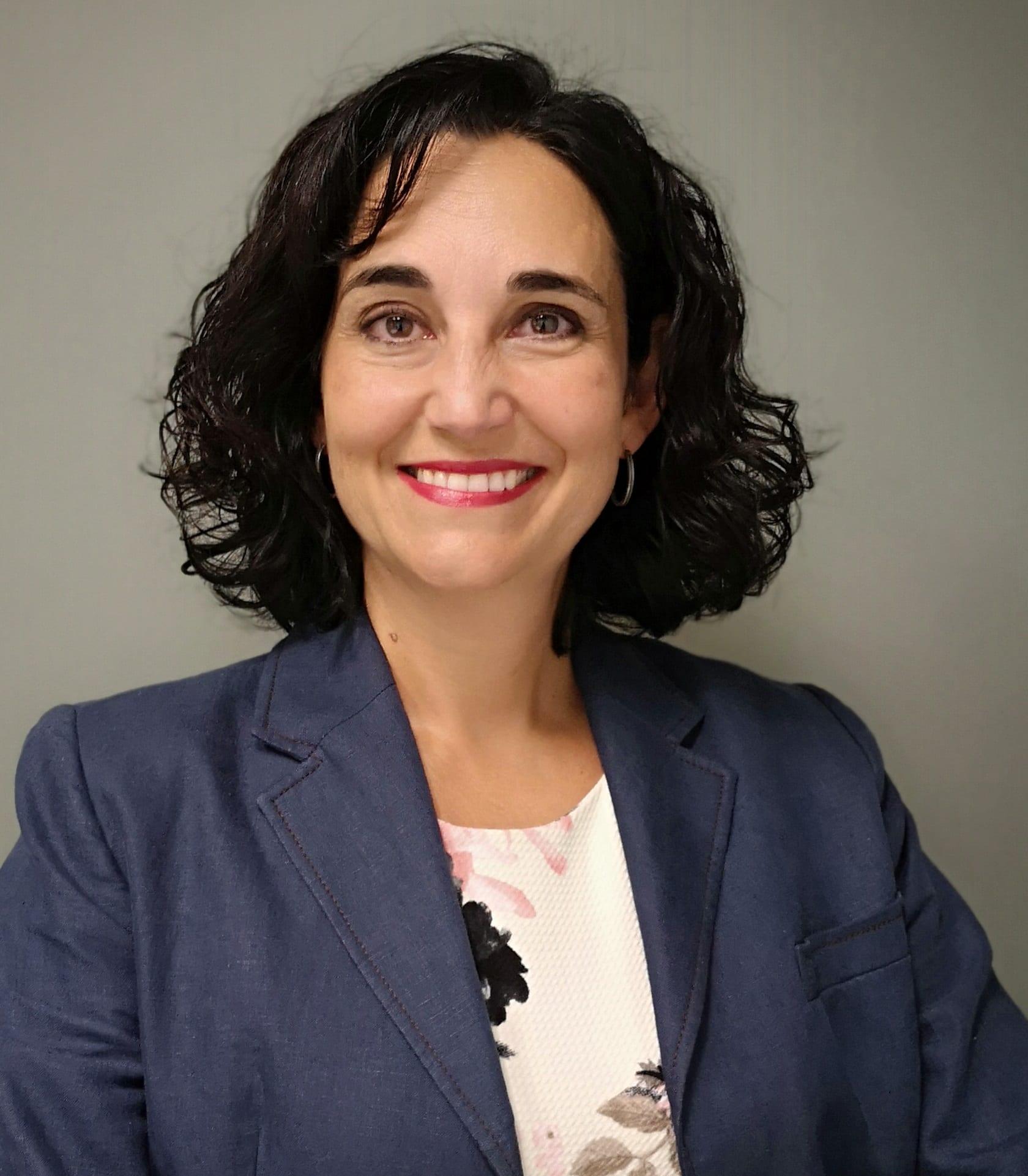 Susana Sierra smiles broadly straight into the camera