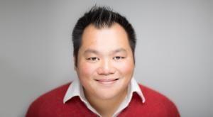 Jon Khoo in a red jumper smiles