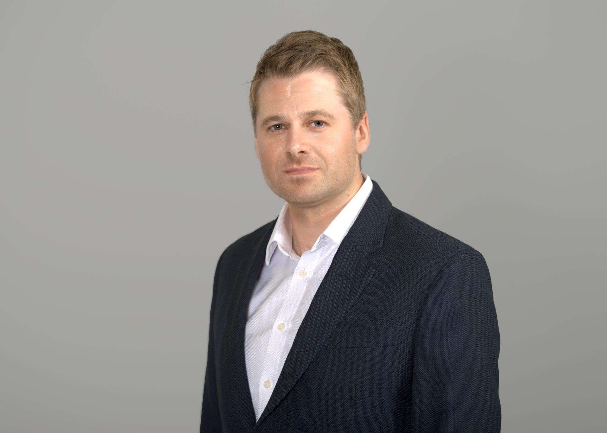 Tom Mullan wearing a suit