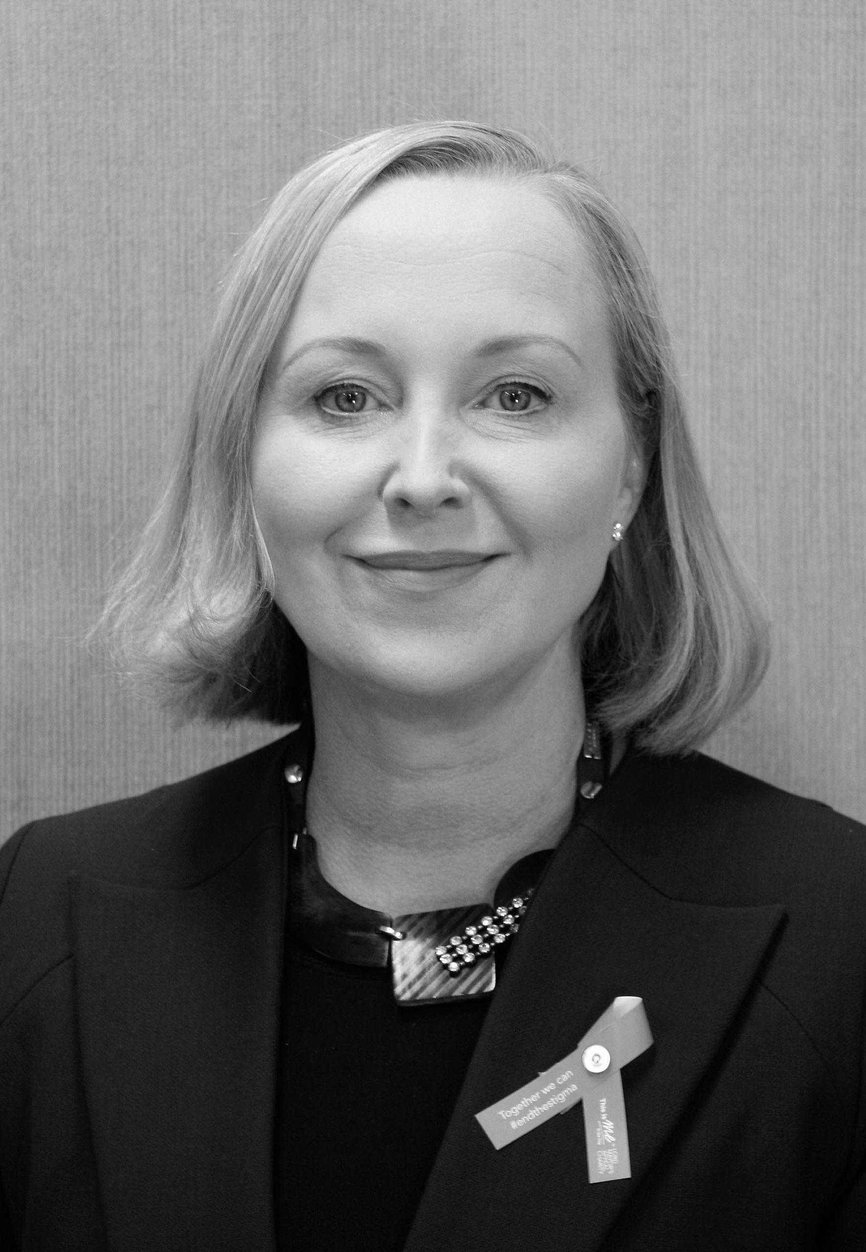 Eva Lindholm smiles in a black and white photo